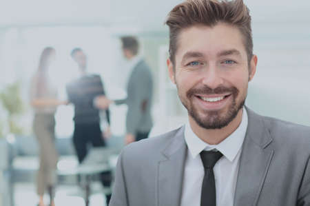 Successful business man in an office with blurred  background Stock Photo