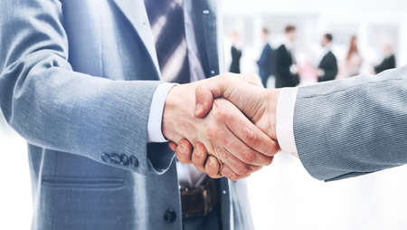 int: Closeup of handshake as a sign of successful cooperation and int Stock Photo