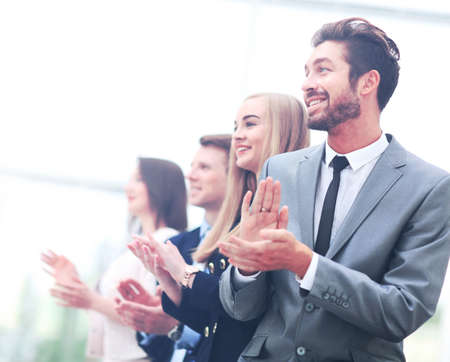 hands work: Satisfied proud business team clapping hands Stock Photo