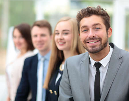 Elegant co-workers looking at camera during meeting in office Stock Photo