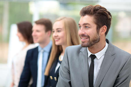 business direction: Business people standing in a row looking in same direction Stock Photo