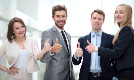 happy workers: Elegant co-workers looking at camera during meeting in office Stock Photo