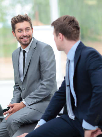 formal dressing: Two handsome businessmen working together on a project in the of