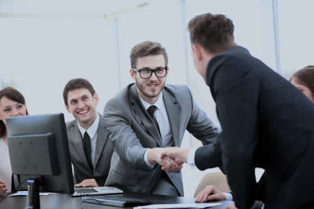 coo: business partners near your Desk to shake hands as a sign of coo