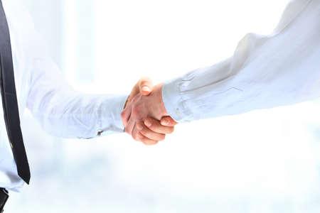 Closeup of a business handshake Reklamní fotografie - 78007476