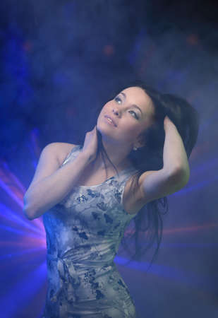 Young womanl dancing in the club Stock Photo