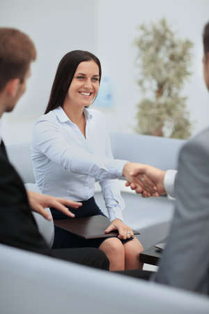 Businesswoman shaking hands to seal a deal with her partner Stock Photo