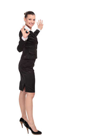 sign: Beautiful business woman is showing okay sign with happiness. Stock Photo