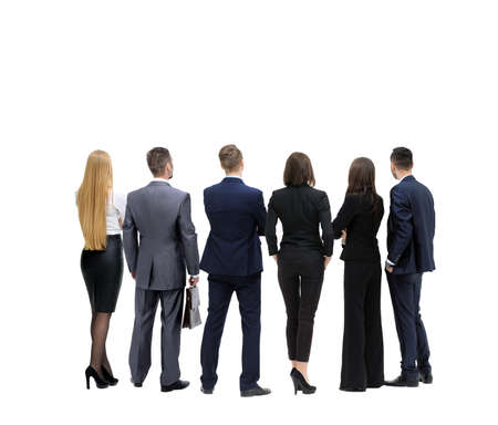 observers: Successful business team looking upwards standing back side