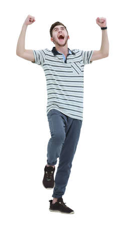 thrilled: Cheering man with his arms raised up on white background.