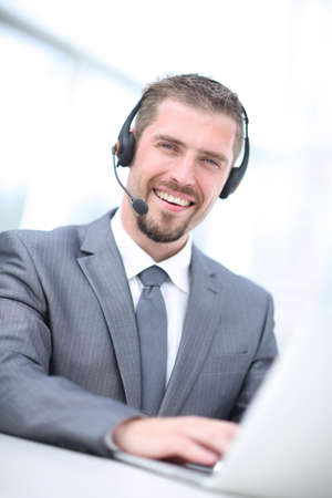 Portrait of  a businessman working at his desk with headset and Stock Photo