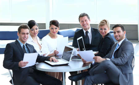 Group of successful business people looking confident photo