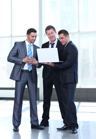 Handsome and confident  business men working at office and plann photo