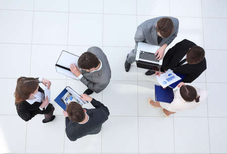 business team with financial documents standing in the lobby Stock Photo
