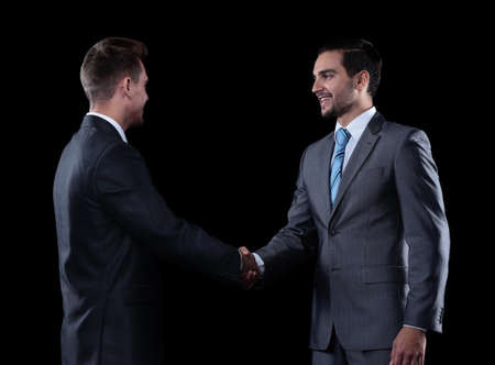 handshake business partners at the meeting photo