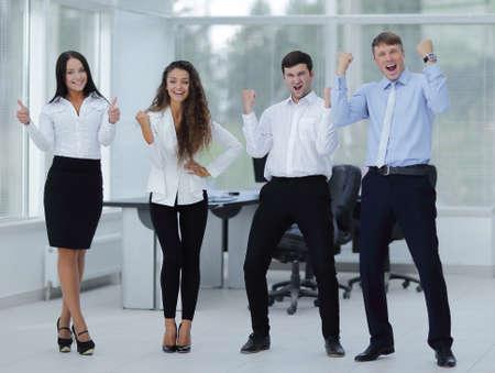 portrait of a triumphant business team photo