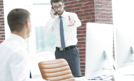 reviews: businessman with smartphone on blurred background office