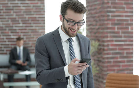 businessman reading text message on smartphone Stock Photo