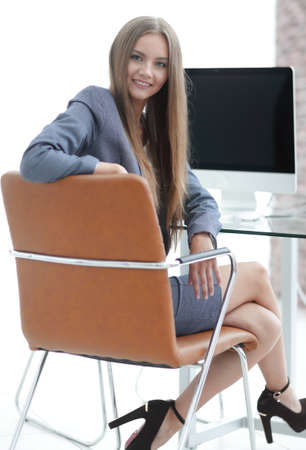 affable: Woman administrator sitting at the workplace
