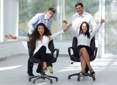 enthusiastic business team in office photo
