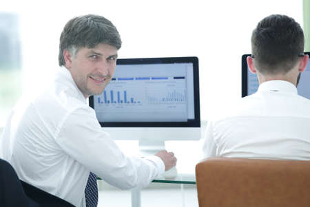 compile: Economists of the company compile financial charts Stock Photo