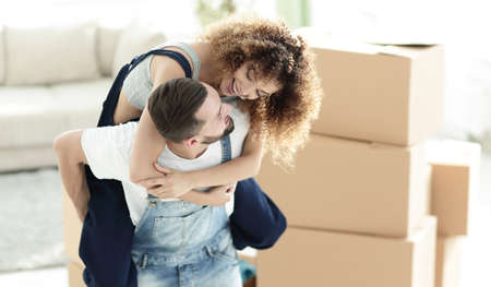 moving box: Wife and husband are happy to move to a new apartment. Stock Photo