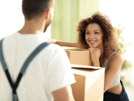 Portrait of a young wife when moving to a new house Stock Photo