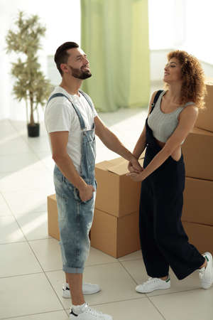 loving young couple standing in a new apartment