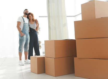 Happy young couple standing in new apartment Stock Photo