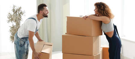complicity: young couple unpacking boxes in a new house