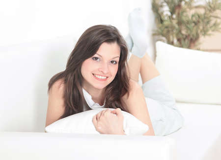 living room window: Happy morning. Pretty young woman waking up
