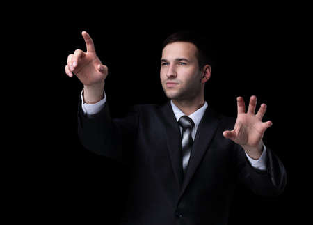 Business man pushing the imaginary  button. Isoladed on black. Stock Photo
