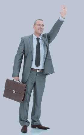 administrador de empresas: Happy mature man in suit smiling while standing