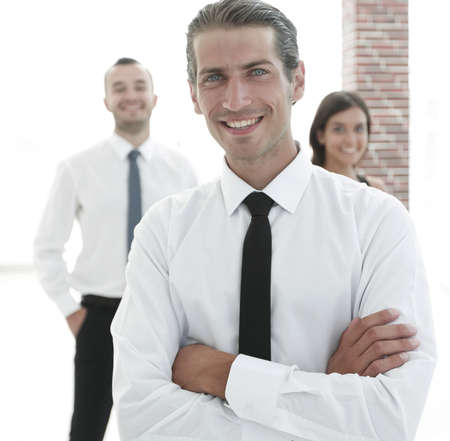 portrait of a successful business person on the background of colleagues. Stock Photo