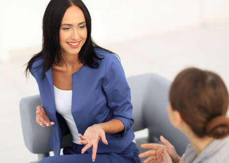 company: attractive business women meet in the office during a break and Stock Photo