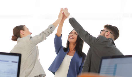 company: Successful businesswomen motivate each other with High Five