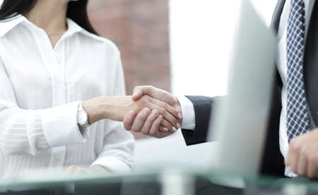 company: close-up of handshake businessman and business woman.