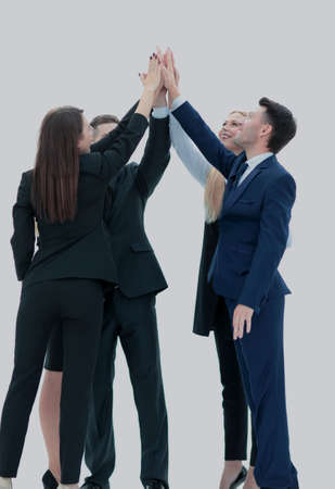 Successful business team giving a high fives gesture as they lau 版權商用圖片