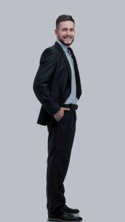 Full length smiling business man looking at camera and standing Stock Photo