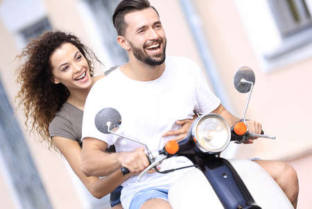 road bike: Cool man and beautiful girl riding on  scooter with  expression
