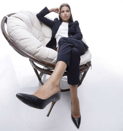 career fair: business woman relaxarea in a comfortable chair