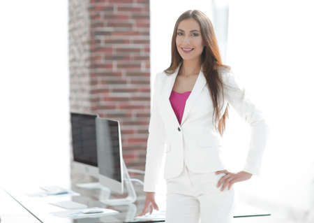 Elegant business woman in a white business suit Stock Photo