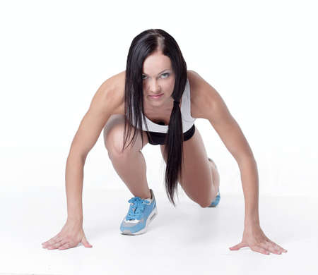 Attractive fitness woman doing low start cross fit exercises