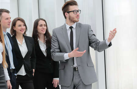 businessman and a group of young business people