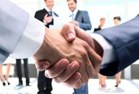 concept of partnership - handshake of business partners
