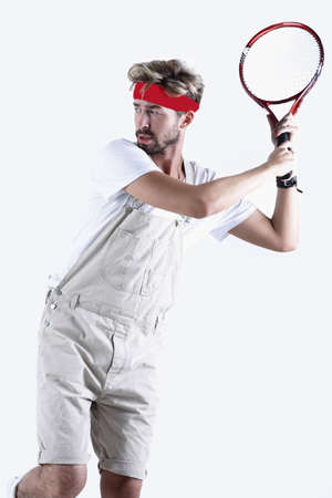 Male tennis player with racket in action. Archivio Fotografico