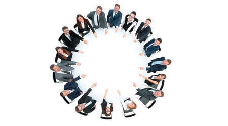 Diverse group pf young business people seated round a table disc Stock Photo