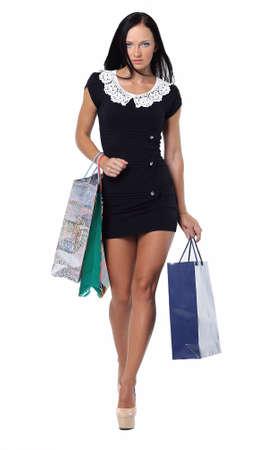 The young girl has a shopping bag.