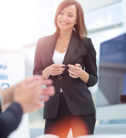 Business and office concept - smiling business team working in