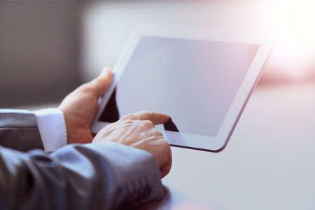 Businessman holding digital tablet in office Banque d'images